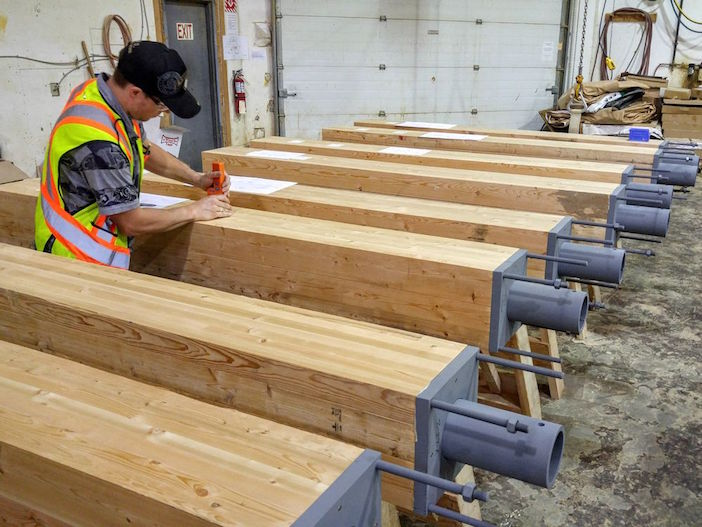 Engineered wood products manufactured for the Brock Commons student residence, an 18-storey mass-timber tower, undergo quality-control inspections at Structurlam Products LP's plant in Penticton.